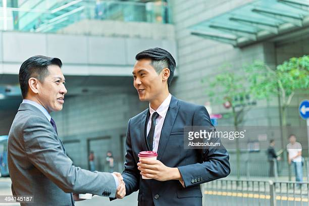 Two Businessmen Shaking Hands, Evening, Hong Kong, China