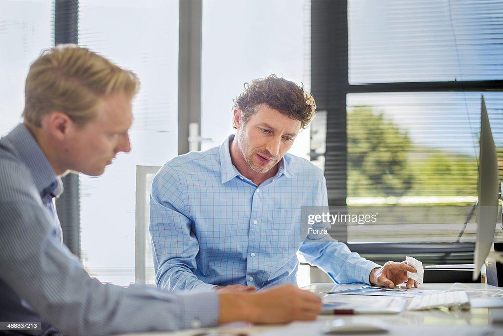 Two businessmen sitting at desk
