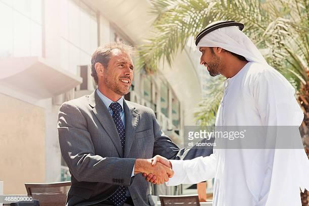 Two businessmen struck a deal in Dubai