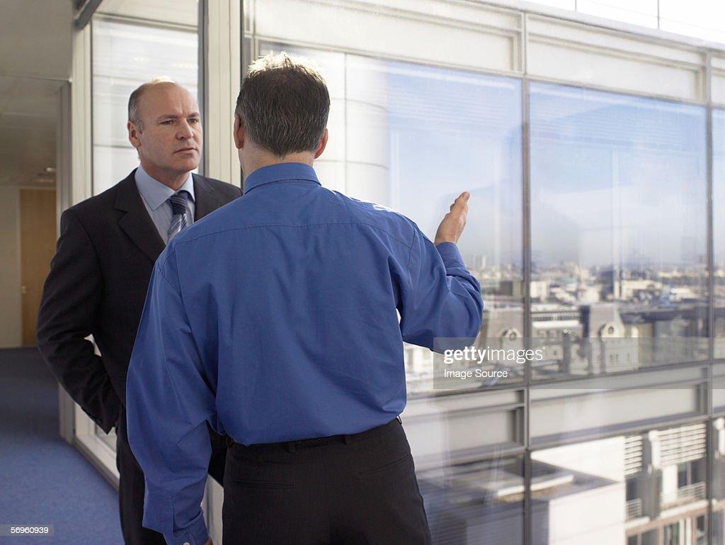 Two businessmen talking : Stock Photo