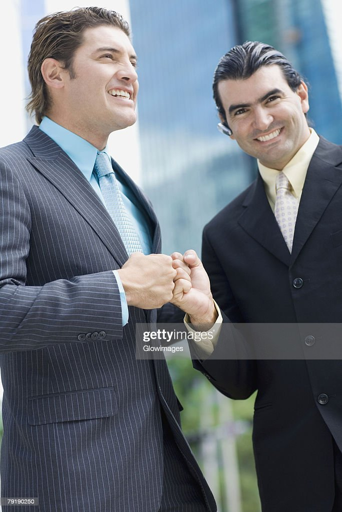 Two businessmen touching fists : Foto de stock