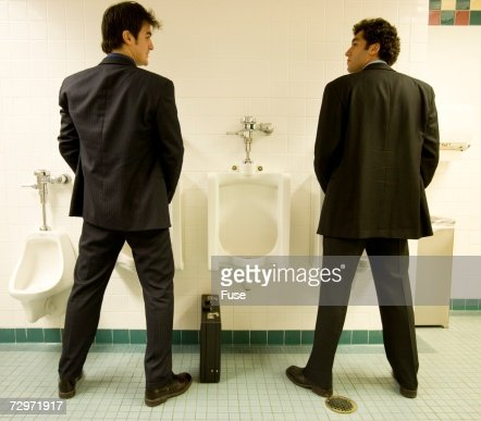 1. Men Using Urinals In Public Bathroom Stock Photo   Getty Images