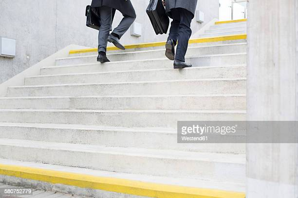 Two businessmen walking on stairs