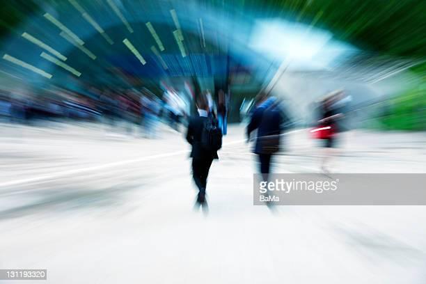 Two Businessmen Walking Towards Subway Station