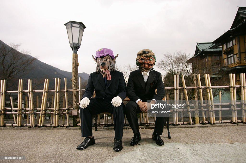 Two businessmen wearing masks : Stock Photo