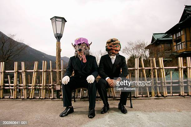 Two businessmen wearing masks