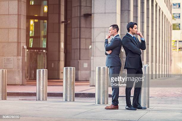 Two businessmen with conflicting ideas