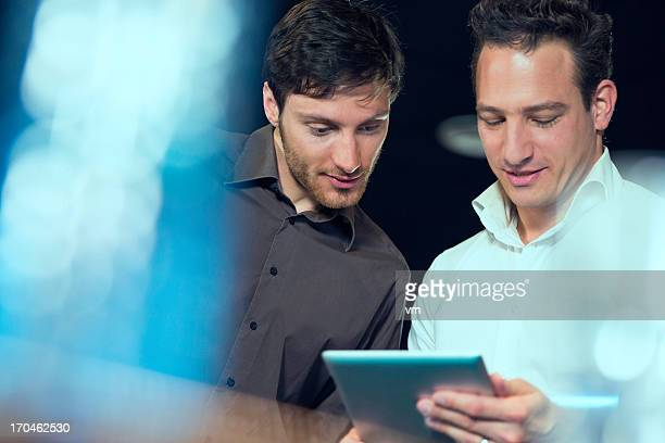 Two businessmen with digital tablet