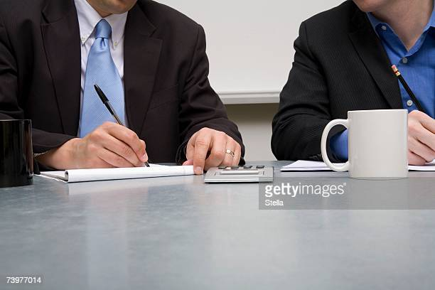 Two businessmen working at a table