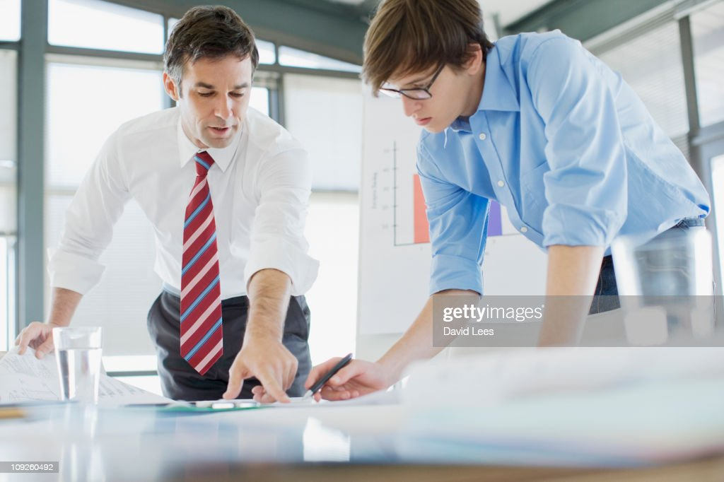 Two businessmen working on paperwork : Stock Photo