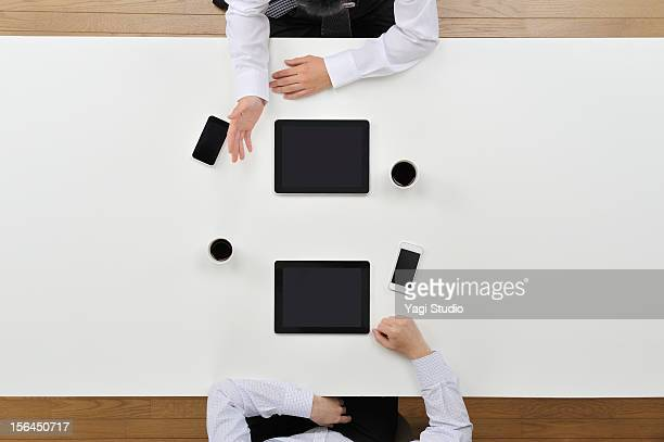 Two businessmenn having discussion on desk