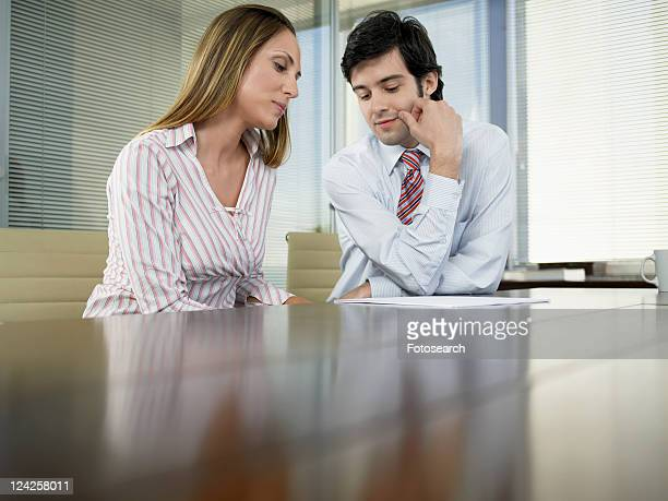 Two businesspeople having meeting (low angle view)