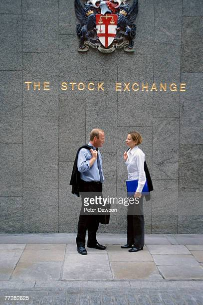 Two businesspeople outside of the London Stock Exchange