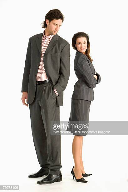 Two businesspeople standing back to back