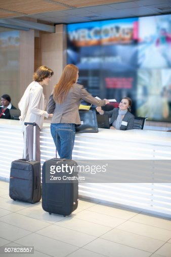 Two businesswoman checking in at conference centre