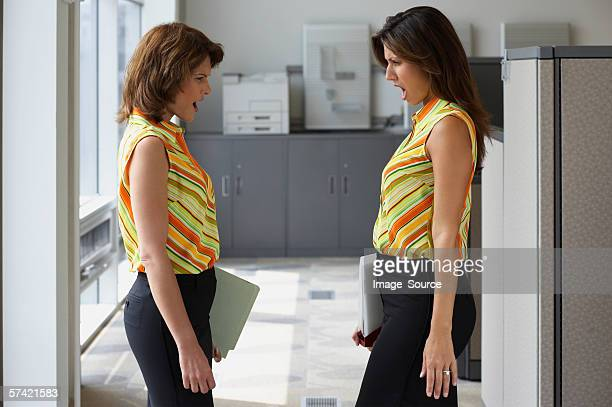 Two businesswoman wearing matching outfits