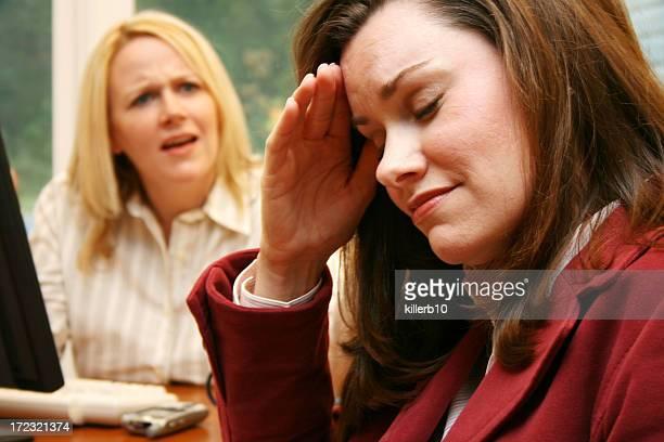 Two businesswomen arguing