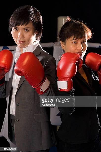 Two businesswomen in a boxing ring