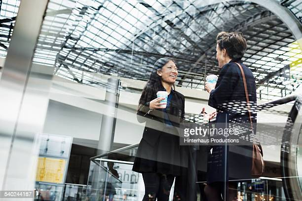 Two Businesswomen Meeting At Trainstation