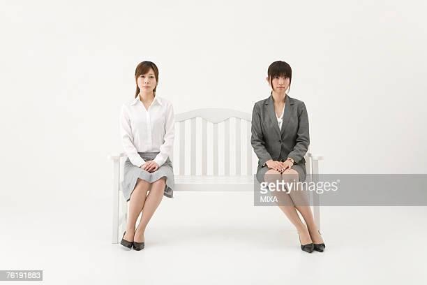 Two businesswomen sitting on bench