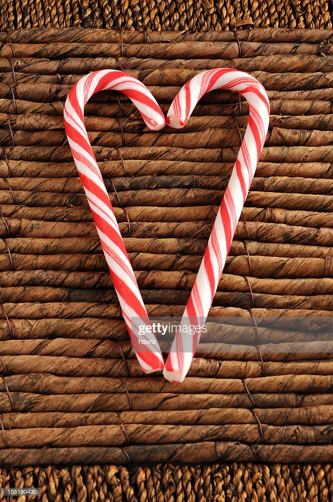 two candy canes for Christmas on reed background