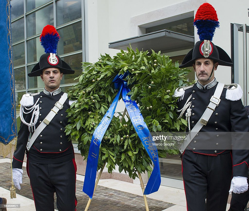 Two Carabinieri hold the wreath of the President of Senato during the remembrance for the Vajont victims on the 50th anniversary on October 9, 2013 in Longarone, Italy. The Vajont disaster occurred on October 9, 1963 and claimed 2000 lives, making it the worst landslide in European history.