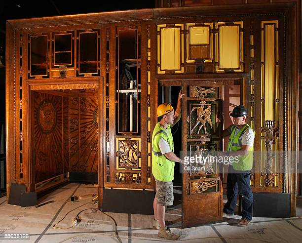 Two carpenters install an original 1928 lift from Selfridges department store into the Museum Of London on June 23 2009 in London England The lift...