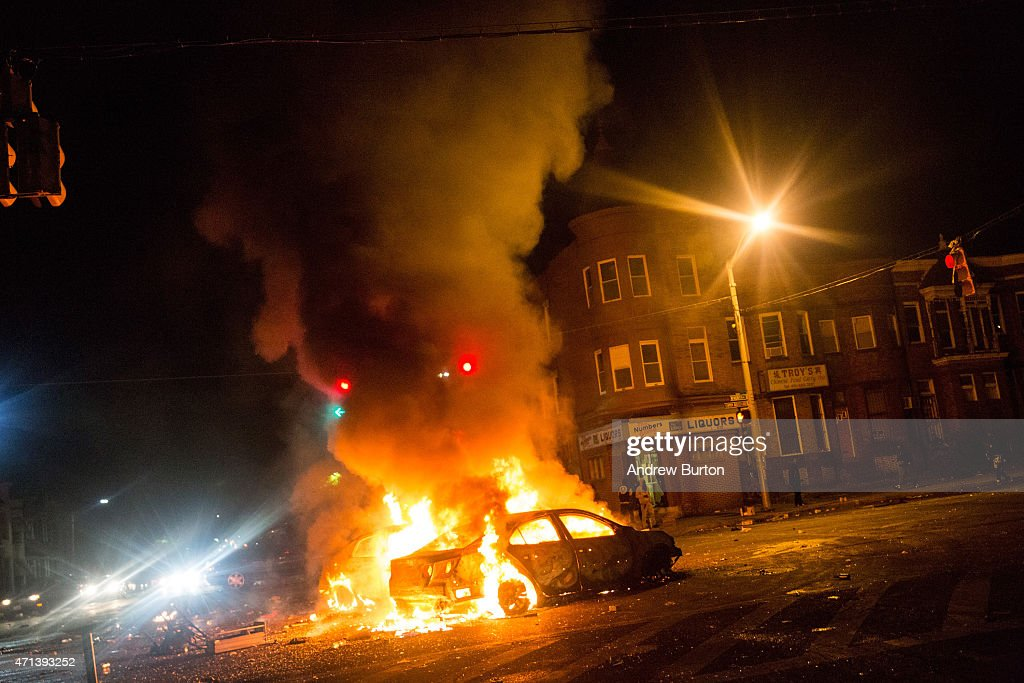 Two cars burn in the middle of an intersection at New Shiloh Baptist Church on April 27 2015 in Baltimore Maryland Riots have erupted in Baltimore...