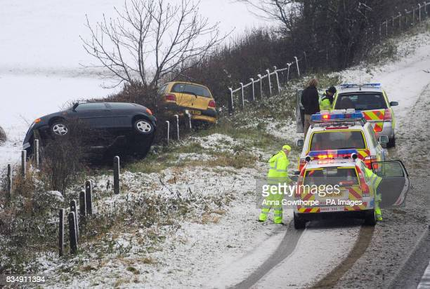 Two cars in a ditch at the side of the A64 road near York as snow hits the UK