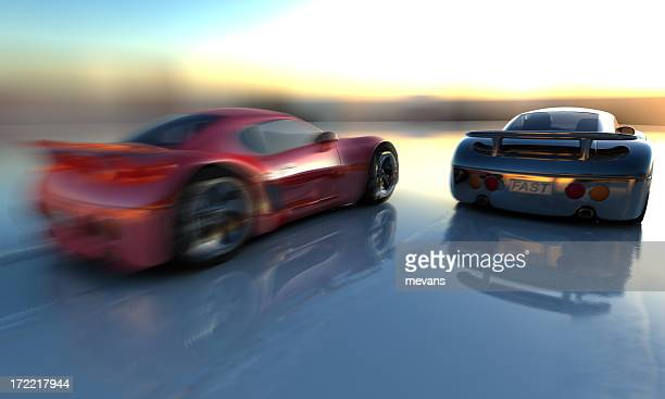 Two cars shown from behind in sunset