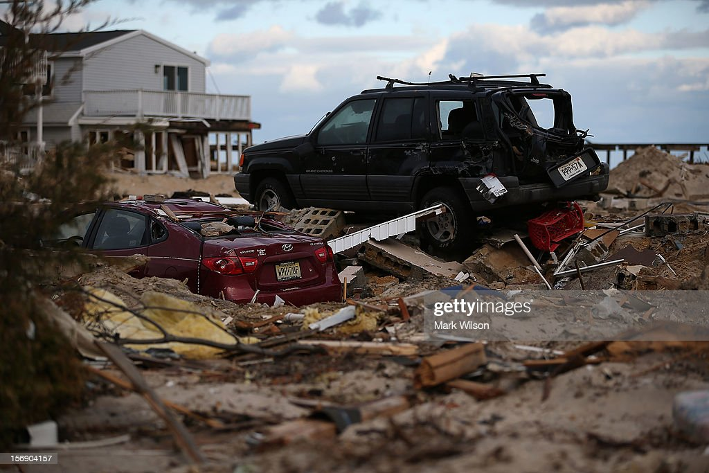 Two cars sit on empty lots where houses once stood, detroyed by Superstorm Sandy, on November 24, 2012 in Ortley Beach, New Jersey. New Jersey Gov. Christie estimated that Superstorm Sandy will cost New Jersey $29.4 billion in damage and economic losses.