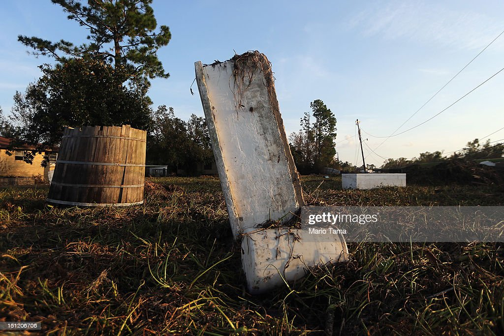 Two caskets are stuck in the mud from Hurricane Isaac flooding in Plaquemines Parish on September 3, 2012 in Braithwaite, Louisiana. Damage totals from the storm could top $2 billion and more than 125,000 customers are still without power six days after the storm made landfall.