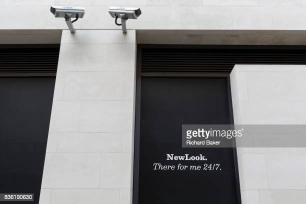 Two CCTV cameras on a wall outside a shop of New Look in the City of London one of the mostwatched cities in the world on 11th August in London...