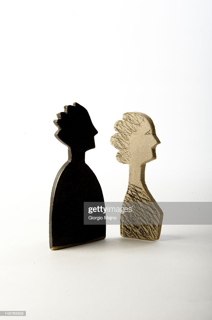 Two ceramic busts: a black man and a white woman : Stock Photo