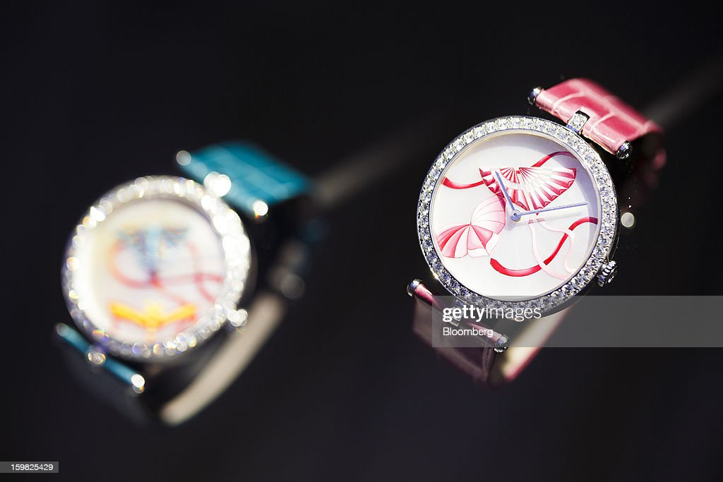 Two Cerf-Volant Carmin, left, and Fuchsia watches manufactured by Van Cleef & Arpels, a unit of Cie. Financiere Richemont SA, sit on display on the first day of the Salon International de la Haute Horlogerie (SIHH) watch fair in Geneva, Switzerland, on Monday, Jan. 21, 2013. The Swiss watch industry slowed in the second half of 2012 as sales of timepieces and jewelry in Hong Kong, the biggest market for Swiss watchmakers, declined in August and October. Photographer: Valentin Flauraud/Bloomberg via Getty Images