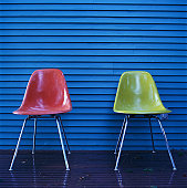 Two Chairs Against Wood Paneling