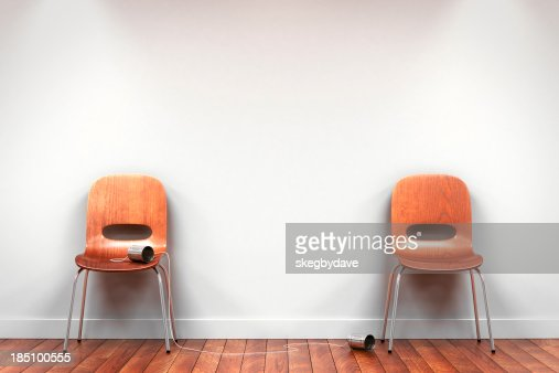 Two chairs with tin can phone
