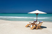 two chairs with umbrella on a beach in Florida