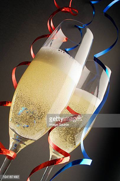 Two champagne glasses with red and blue streamers