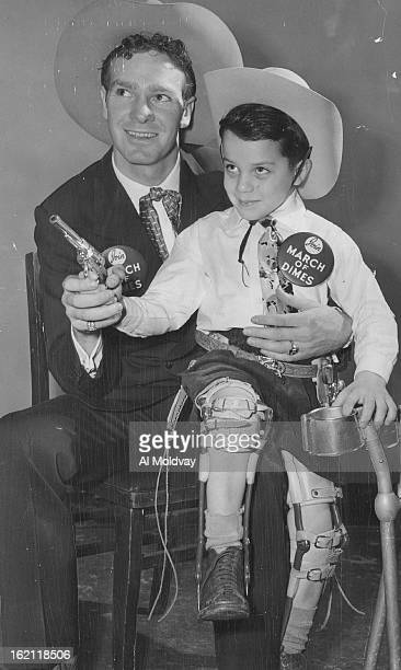 JAN 17 1955 JAN 20 1955 Two championsáplucky Harold Rhoades of 940 Grove St the 5yearold 'poster boy' in the Denver March of Dimes and Casey Tibbs...