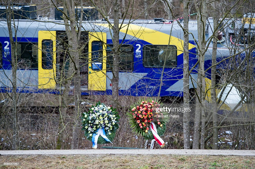 Two chaplets stand in front of the wreckage of two trains that collided head-on the day before in Bavaria on February 10, 2016 near Bad Aibling, Germany. Authorities say at least nine people are dead and over 100 injured in the collision between two trains of the Meridian local commuter train service that occurred at approximately 7:00 am yesterday.