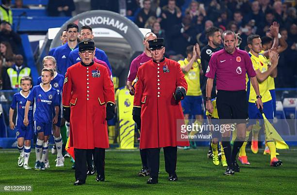 Two chelsea pensioners lead the teams out prior to kick off during the Premier League match between Chelsea and Everton at Stamford Bridge on...