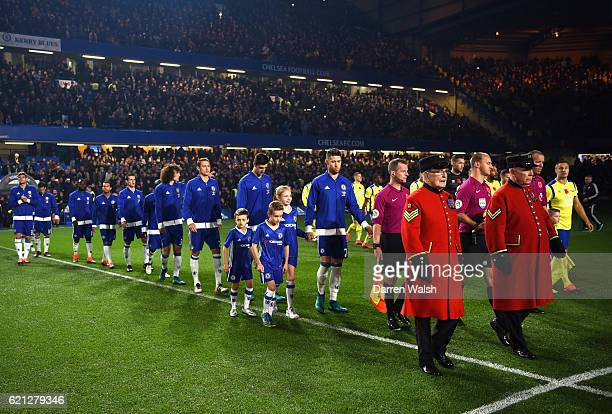 Two chelsea pensioners lead the two teams out during the Premier League match between Chelsea and Everton at Stamford Bridge on November 5 2016 in...