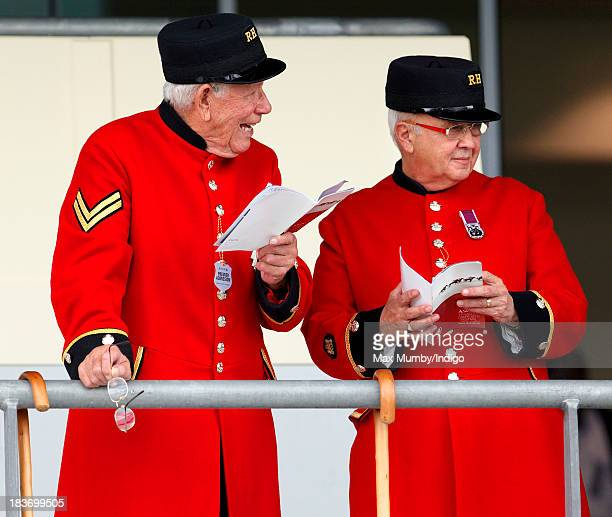 Two Chelsea Pensioners study their race cards as they attend the CAMRA Beer Festival Race Day at Ascot Racecourse on October 5 2013 in London England