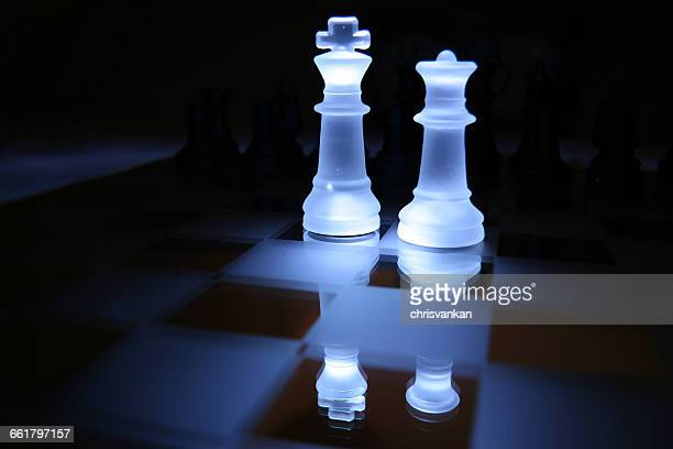 Two chess pieces on chess board