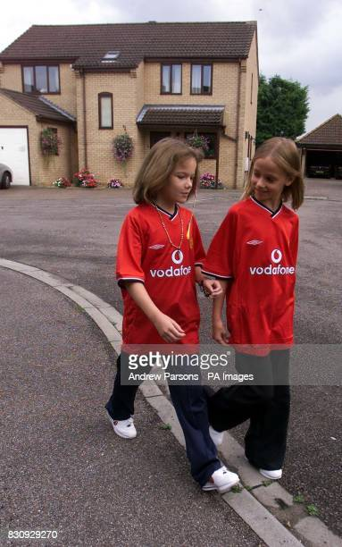 Two child actors playing Jessica Chapman left and Holly Wells leave Redhouse Gardens as they take part in a police reconstruction in Soham...