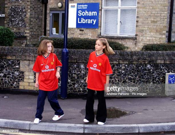 Two child actors playing Jessica Chapman left and Holly Wells walk past Soham Library in Clay Street as they take part in a police reconstruction in...