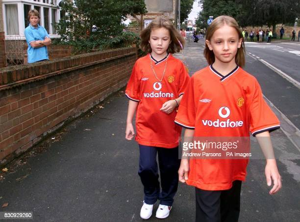 Two child actors playing Jessica Chapman left and Holly Wells walk down Sand Street as they take part in a police reconstruction in Soham...