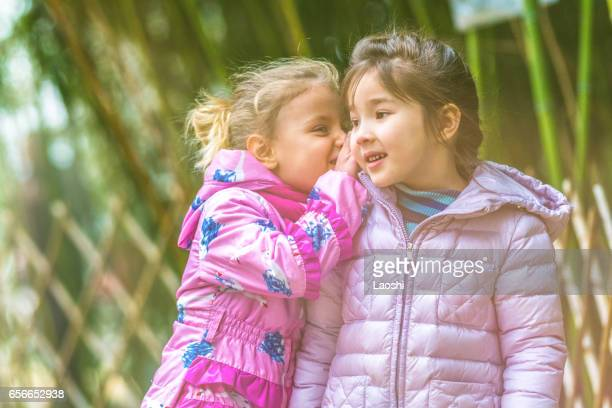 Two child funning in park, outdoors shot
