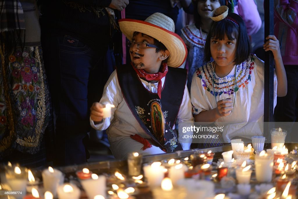 Two children attend the celebration of the apparition of the Virgin of Guadalupe to Juan Diego in Mexico in 1531 at the basilica of the Virgin of...
